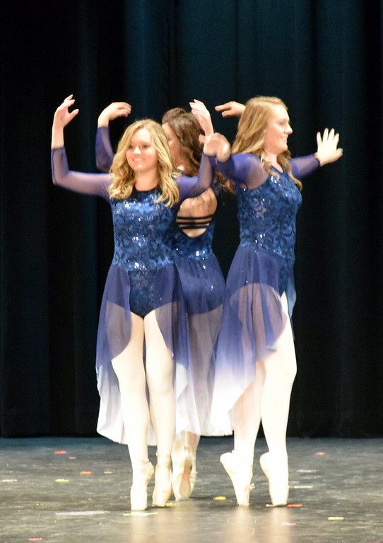 """. Sonjia Hadley, Emory Underwood and Sydney Wright dance to \""""Only Just Met You\"""" at Melissa\'s School of Dance and Gymnastics\' \""""Dance In Motion\"""" recital Wednesday, June 13, 2018."""
