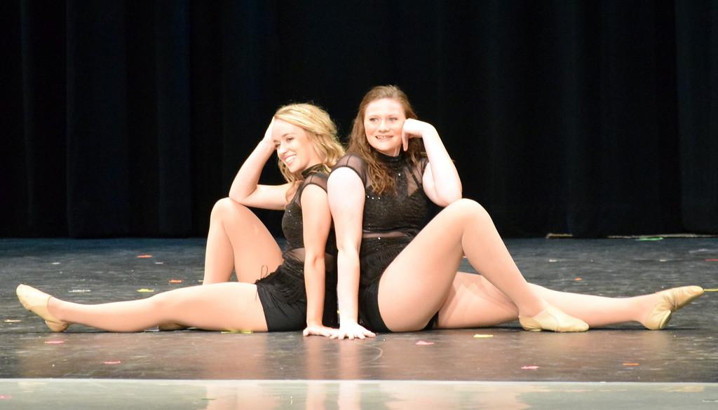 ". Maggie Alsup and Katie Master dance to \""Spotlight\"" during Melissa\'s School of Dance and Gymnastics\' \""Dance In Motion\"" recital Wednesday, June 13, 2018."