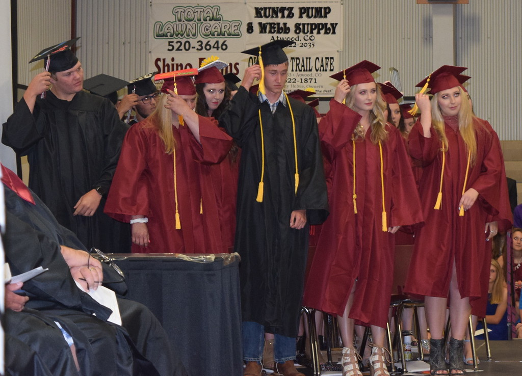 . The new 2018 Merino High School graduates flip their tassels during the commencement ceremony Sunday, May 20, 2018.