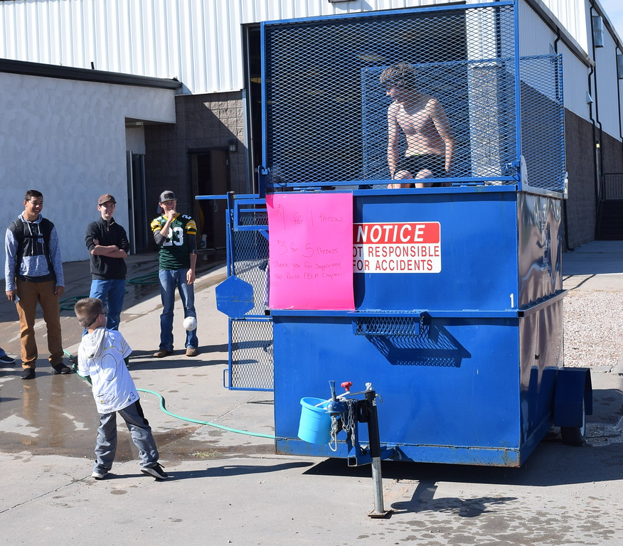 ". An FBLA dunk tank fundraiser provided fun for all ages looking to make a splash at Peetz Sake Days ""Still on the Hill\"" Centennial Celebration Saturday, Sept. 30, 2017."