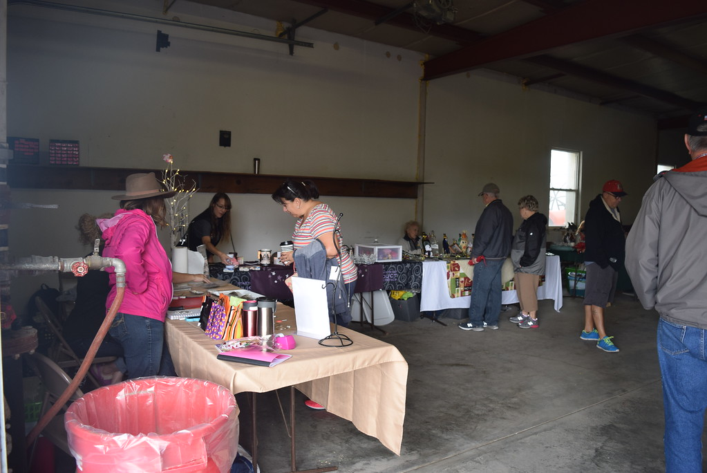". Guests look over items at the craft fair and bake sale that was part of the Peetz Sake Days ""Still on the Hill\"" Centennial celebration Saturday, Sept. 30, 2017"