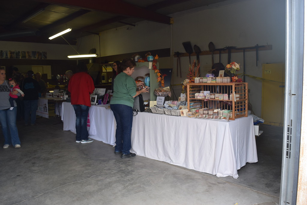 ". Guests look over items at the craft fair and bake sale that was part of the the Peetz Sake Days ""Still on the Hill\"" Centennial celebration Saturday, Sept. 30, 2017."
