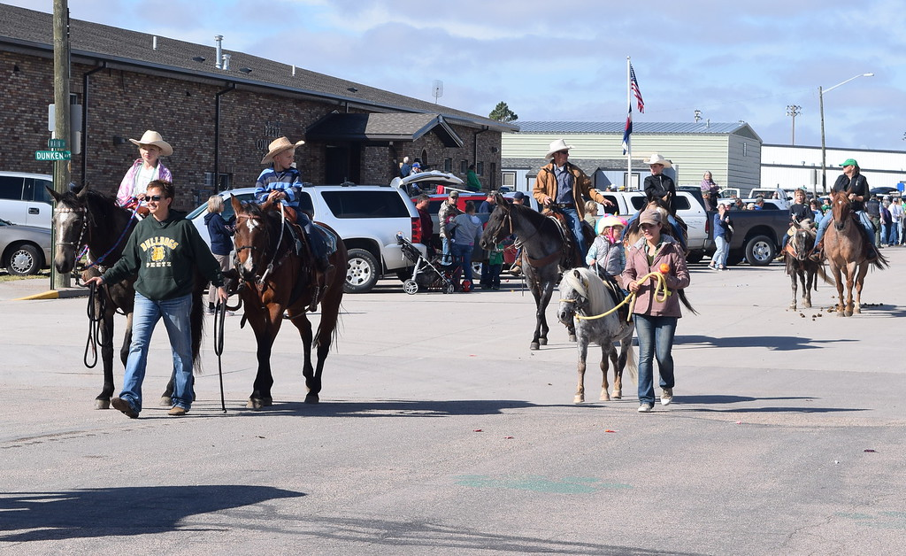 ". Horseback riders make their way down the parade route during the Peetz Sake Days ""Still on the Hill\"" Centennial Parade Saturday, Sept. 30, 2017."