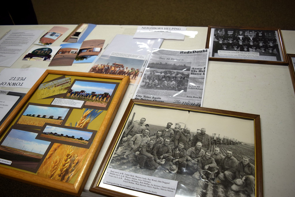 ". Photographs showing ""Neighbors Helping Neighbors\"" were on display at Peetz Sake Days \""Still on the Hill\"" Centennial Celebration Saturday, Sept. 30, 2017."