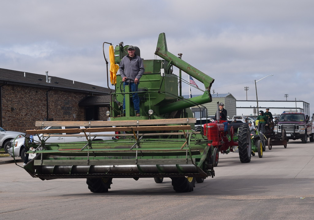 ". Adam Davis leads several pieces of farm equipment during the Peetz Sake Days ""Still on the Hill\"" Centennial Parade Saturday, Sept. 30, 2017."