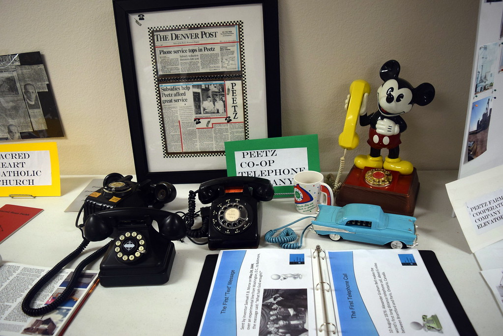 ". Phones have come a long way over the years, as seen in the Peetz Co-op Telephone Company\'s display at Peetz Sake Days ""Still on the Hill\"" Centennial Celebration Saturday, Sept. 30, 2017."