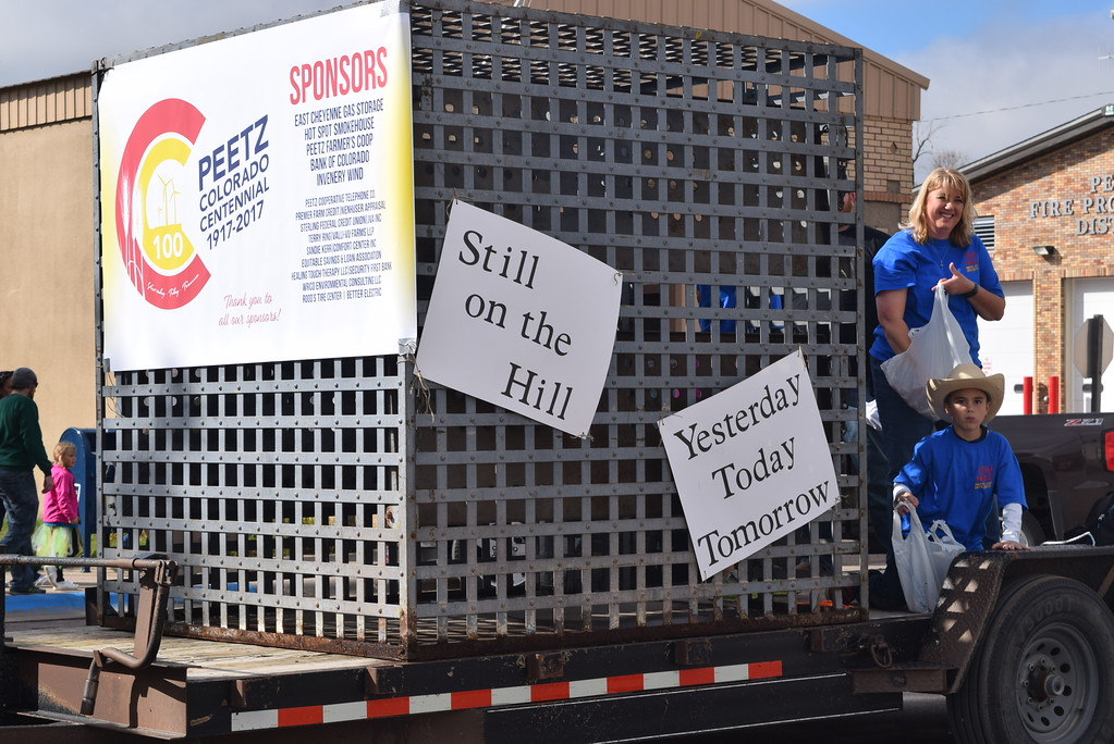 ". The Town of Peetz float used the town\'s old jail cell to make sure paradegoers knew Peetz was and is ""Still on the Hill\"" yesterday, today and tomorrow,  during the Peetz Sake Days \""Still on the Hill\"" Centennial Parade Saturday, Sept. 30, 2017."