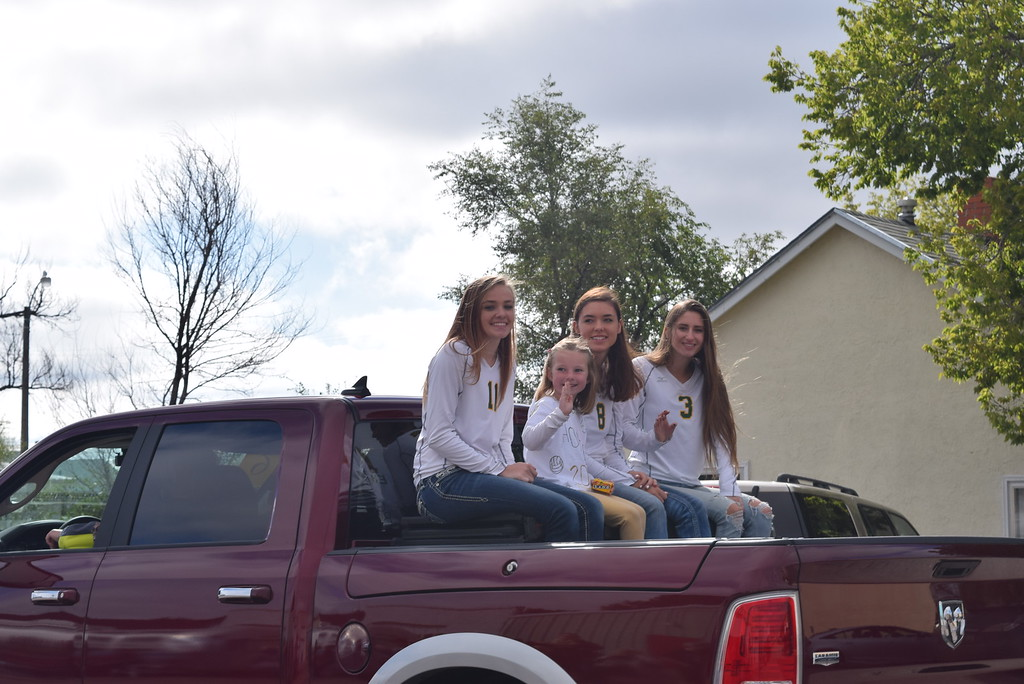 ". Peetz High School volleyball players wave from their truck during the Peetz Sake Days ""Still on the Hill\"" Centennial Parade Saturday, Sept. 30, 2017."