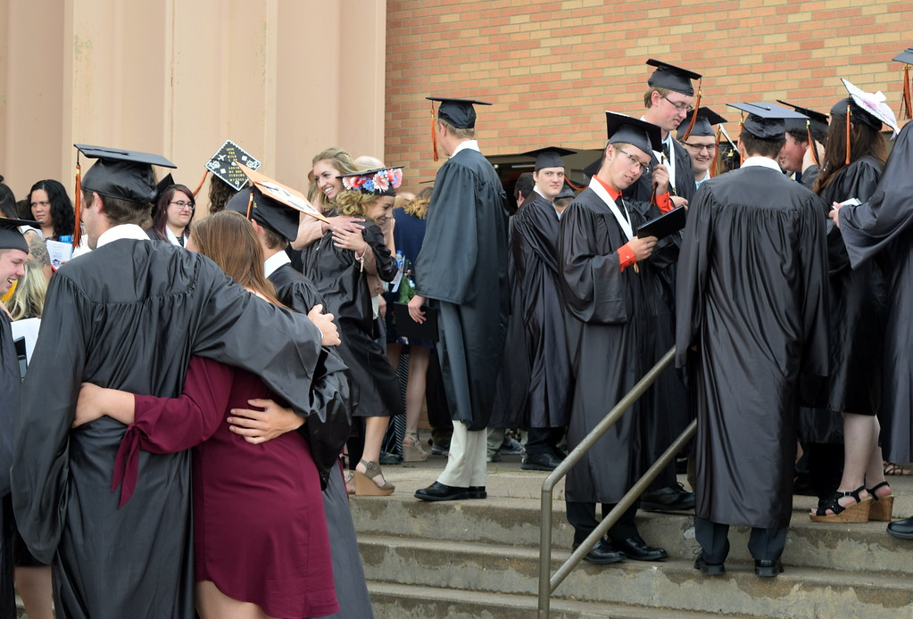 . Sterling High School graduates congratulate each other following commencement exercises Saturday, May 27, 2017.