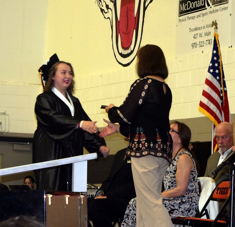 . Samantha Freeland receives her diploma at Sterling High School\'s commencement exercises Saturday, May 27, 2017.