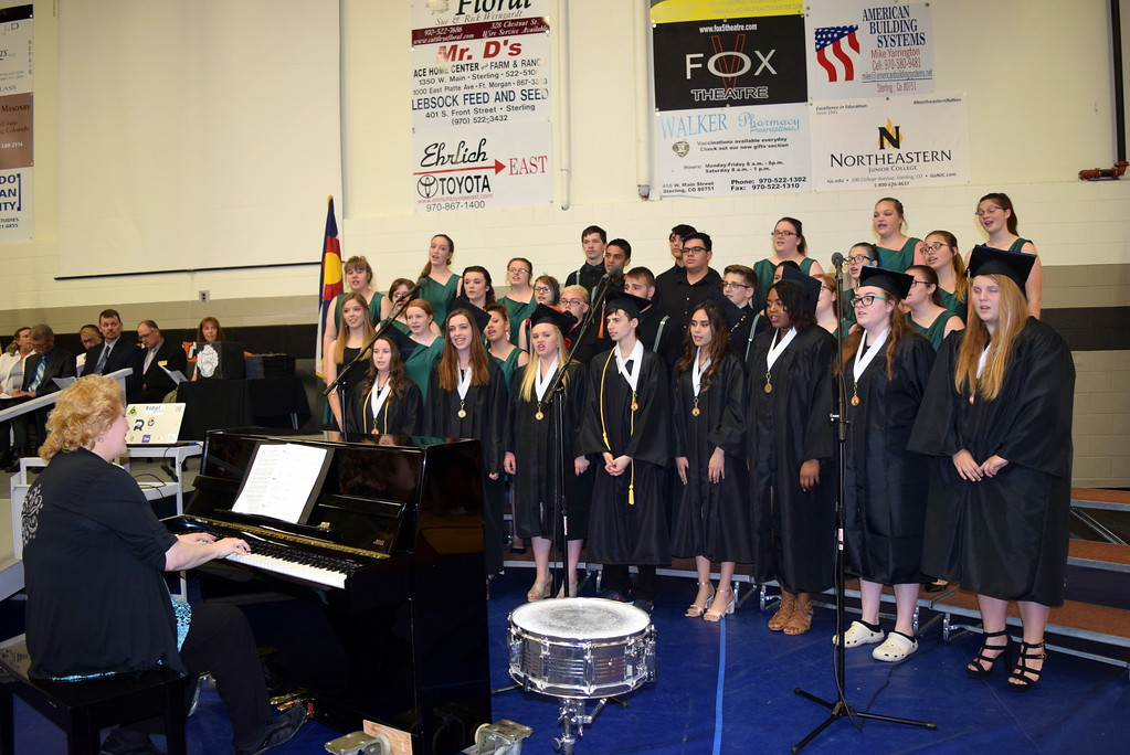 """. The Sterling High School Jazz Choir and Senior Concert Choir Members perform The SHS Class of 2018 Mash-Up \""""My Wish/Hope You Dance/The Climb/You Raise Me Up,\"""" under the direction of Annette Lambrecht, during the school\'s commencement exercises Saturday, May 26, 2018."""
