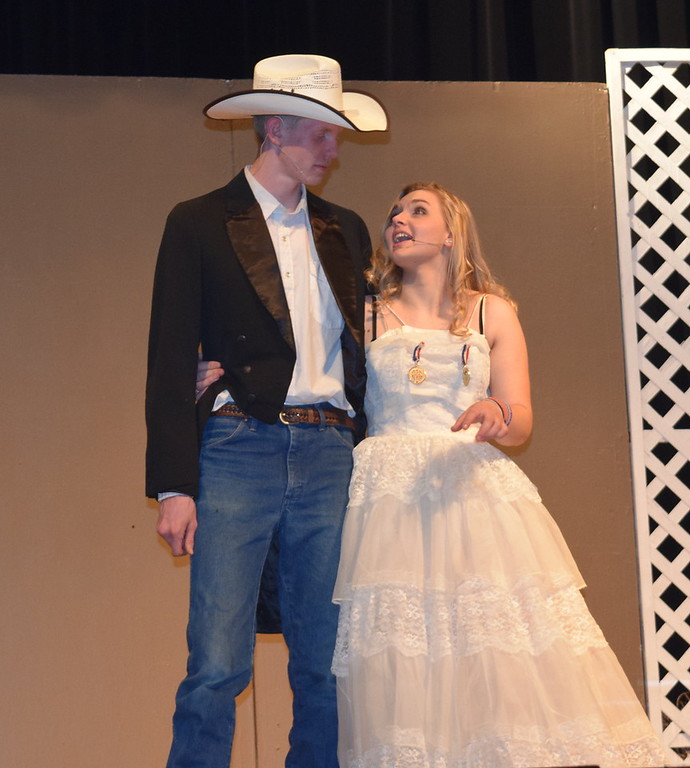 """. Annie Oakley (Kori Penfold) looks adoringly at her love Frank Butler (Tyler Parks) as they perform \""""They Say It\'s Wonderful\"""" in a scene from Sterling High School\'s upcoming production of \""""Annie Get Your Gun.\"""""""