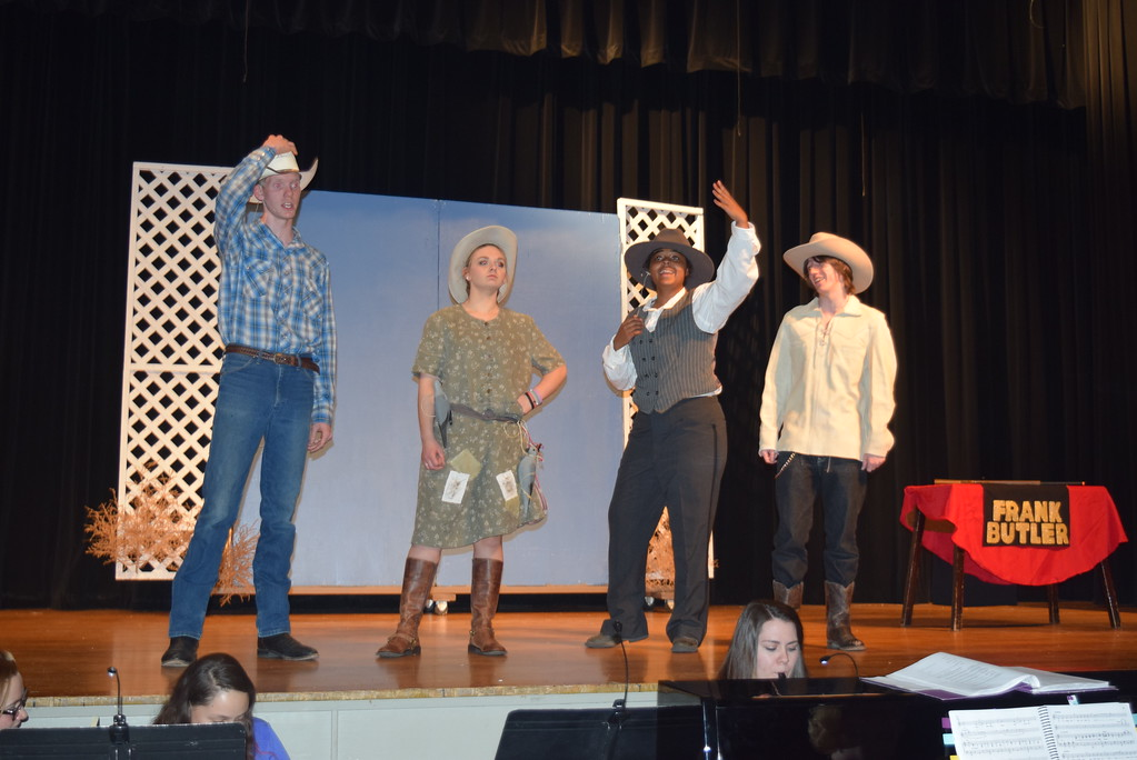 """. From left; Frank Butler (Tyler Parks), Annie Oakley (Kori Penfold), Charlie Davenport (Julia Ssessanga) and Buffalo Bill Cody (Clifford Farrington) have a conversation in a scene from Sterling High School\'s upcoming production of \""""Annie Get Your Gun.\"""""""