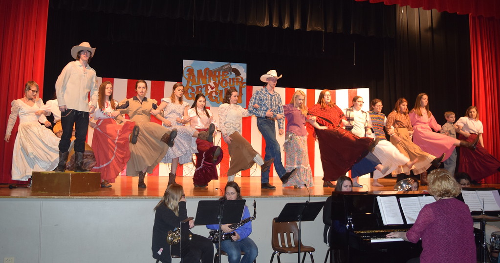 """. The cast of Sterling High School\'s upcoming production of \""""Annie Get Your Gun\"""" sings and dances to \""""Colonel Buffalo Bill\"""" during a rehearsal. \""""Annie Get Your Gun\"""" hits the stage April 6-8, in SHS auditorium."""