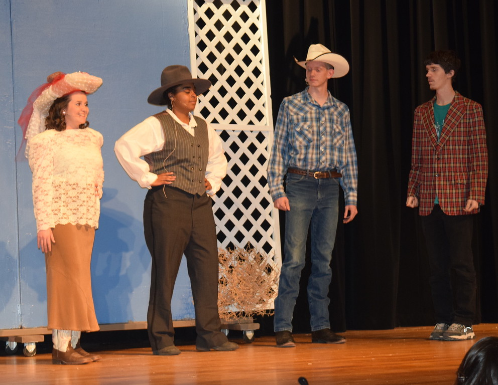 """. From left; Grace Reeves (Dolly Tate), Julia Ssessanga (Charlie Davenport), Tyler Parks (Frank Butler) and Michael Kenner (Foster Wilson) rehearse a scene from Sterling High School\'s upcoming production of \""""Annie Get Your Gun.\"""""""