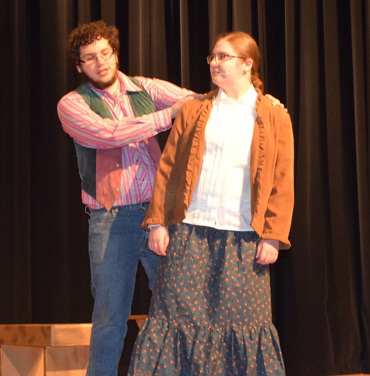 """. Tommy Keeler (Christian Scott), a knife-thrower in Buffalo Bill Cody\'s Wild West Show, and his girlfriend Winnie Tate (Camryn Trump) perform \""""I\'ll Share It All With You\"""" in a scene from Sterling High School\'s upcoming production of \""""Annie Get Your Gun.\"""""""