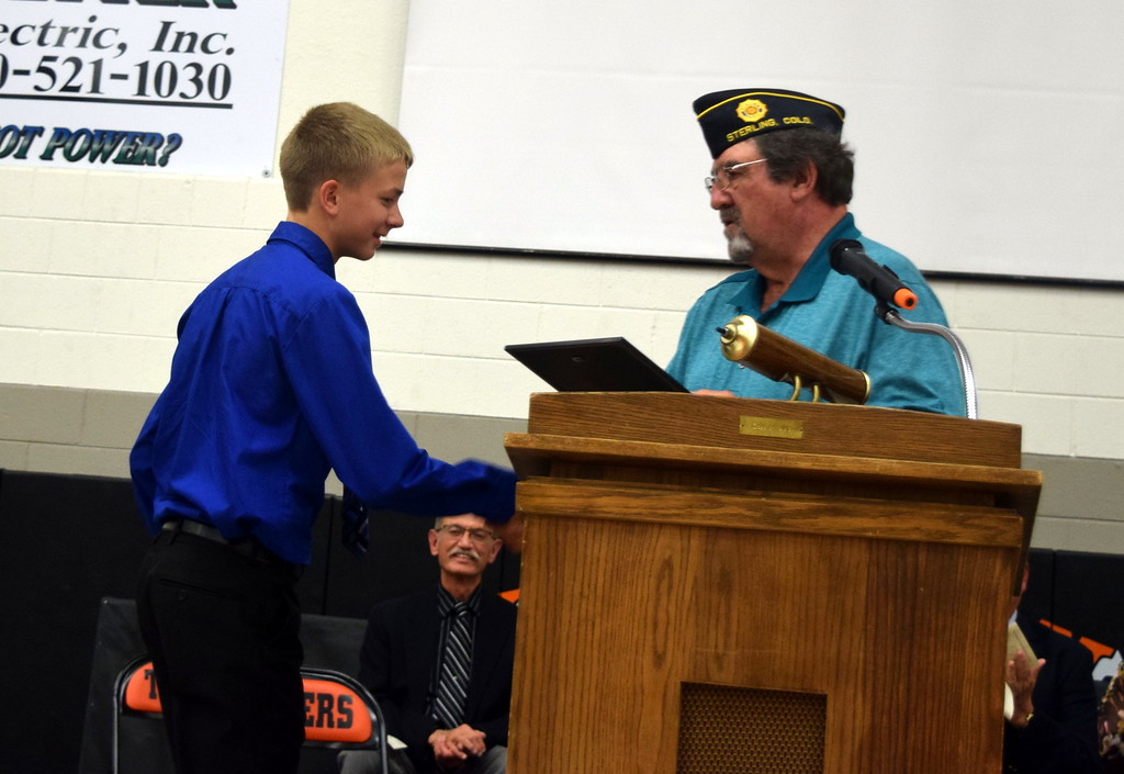 . Aaron Lenox receives the Outstanding Girl Award from Dave Conley, finance officer with American Legion Sterling Post No. 20, at Sterling Middle School\'s Continuation Night Tuesday, May 23, 2017.