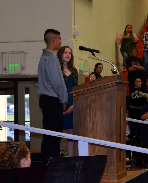 . Eighth grade co-student council vice presidents Devin Bernatchez and Samantha Kelsch lead the flag salute at Sterling MIddle School\'s Continuation Night Tuesday, May 23, 2017.