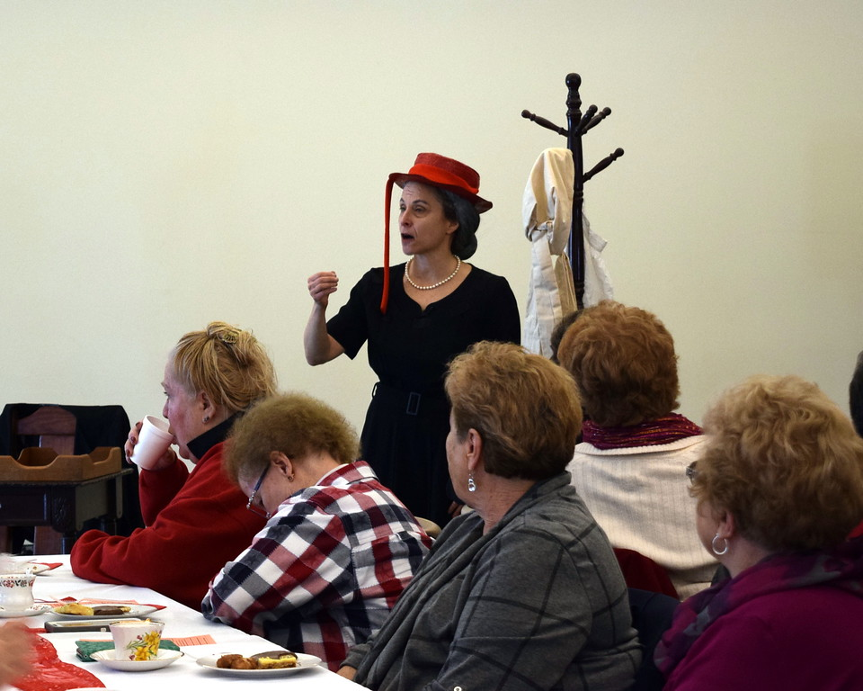 . Guests listen as Helen Trencher portrays Golda Meir, former Prime Minister of Israel, during Sterling Public Library\'s annual Valentine\'s Tea Friday, Feb. 8, 2019.