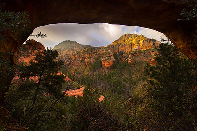 Morning light over Wilson Mountain, framed by Vultee Arch