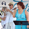 Cynthia Lemen, singer for the band Cool Lemon Jazz, belts out Saturday in the Park by Chicago, during Thursday's Sterlingfest  jazz music program.  Ray Skowronek--The Macomb Daily