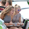 Sarah Beaupre, 14, and her friend Lauren Daily, 14, both of Sterling Heights, hold on tight during the Wipe-Out ride at Sterlingfest.  Ray Skowrnek--The Macomb Daily