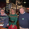 From left, Sun Santa Honorary Chairman John Thibault and his beautiful elf, Elaine Zouzas Thibault of Chelmsford, and Sun Santa President Terry McCarthy of Lowell
