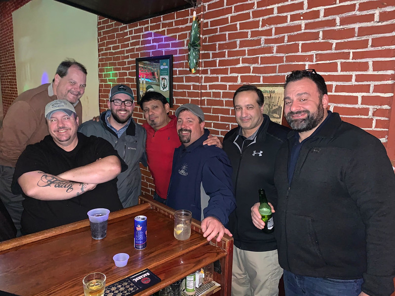 The Blue Shamrock owner Nick Petrakos, center, and his crew