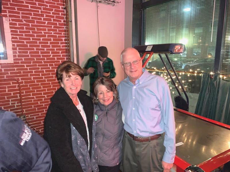 Sun Santa Coordinator Nancy Roberts of Westminster, center, with Laurel and Jim Rivard of Lowell