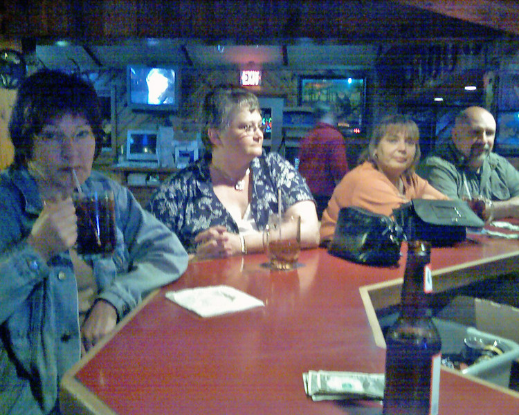 My wife Alice on the left, and friend Judy and neighbors. From my cellphone