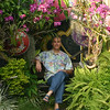 On a bench surrounded by orchids and peacefulness.