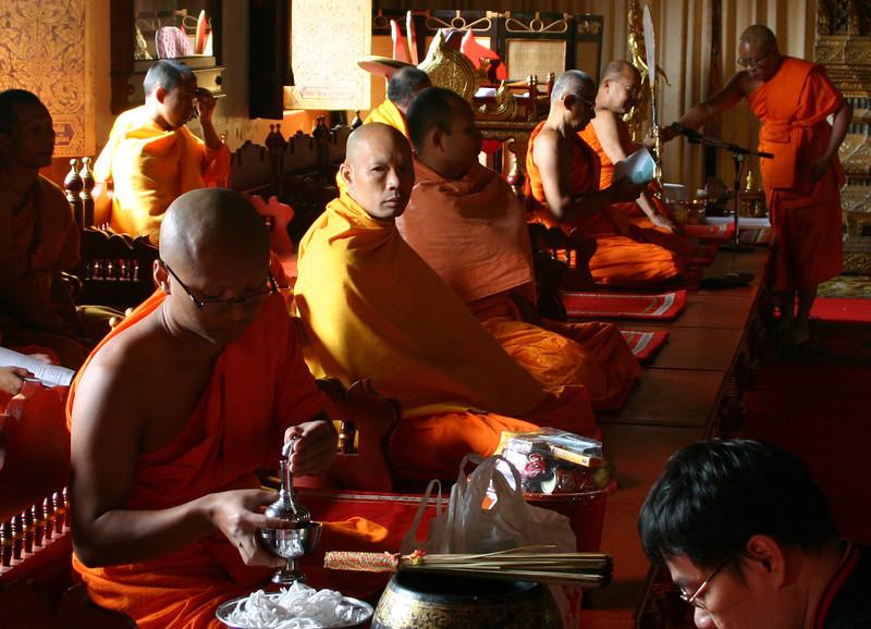 Seated monks at Wat Phra Singh