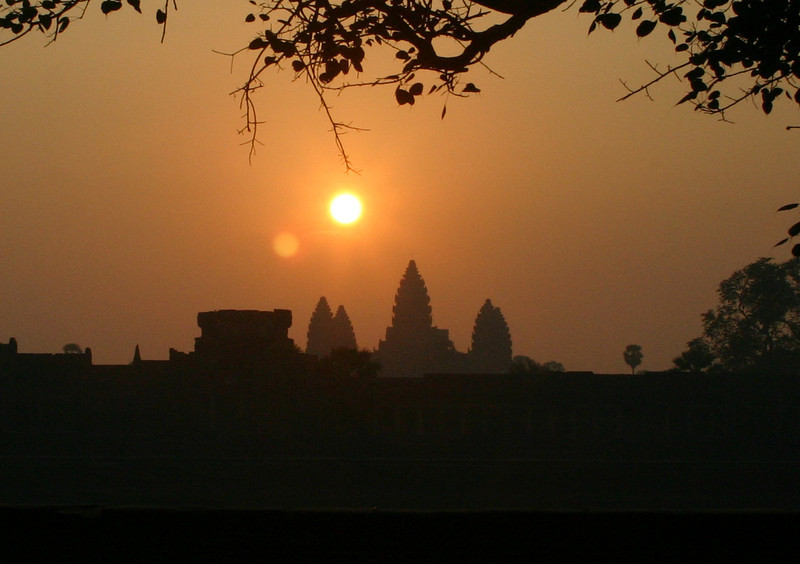 Sunrise over Angkor Wat.    I got up early to be at Angkor Wat at about 5:00 AM to get shots of the sunrise, and they were all junk.   On another day we were bouncing down the road in a tuk-tuk on our way to a different temple and I stuck the camera out the side and got this shot.