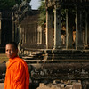 The inner side of the western wall of Angkor Wat, and a monk
