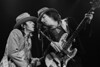 Stevie Ray Vaughan and Tommy Shannon performing at the Greek Theater in Berkeley, CA on October 11, 1985