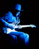 "Stevie Ray Vaughan sits on the stage to play ""Lenny"" at the Greek Theater in Berkeley, CA on 10-11-85."