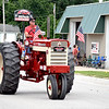 Todd Ohnesorge drove a 1963 Farmall 560 antique tractor in the Red, White and Blue parade in The Village of Stewardson Sunday afternoon. Charles Mills photo