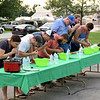 Seven contestants competed in the hot dog eating contest a new activity this year at the Stewardson Independence Day Celebration pictured from left, Andrea Milby, second place winner, John Alward, Wesley Rahn, Quinten Beitz, Tim Waldoff, Zach Weber, first place winner and Josh Tabbert. Charles Mills photo