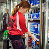 Ari Flanders of Pelham helps put stickers on alcohol beverages at Gage Hill Farms convenience store in  Pelham, to help warn others of the dangers of buying for minors. SUN/Caley McGuane