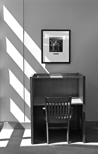 "Tribute to Joe Clark, ""Hillbilly Snap Shooter"".  A gallery of Joe's  black & white photos are displayed in Clayton-Glass Library on Motlow State Community College Campus.  This B&W photo features one of Joe's photos over a sunlit student desk."