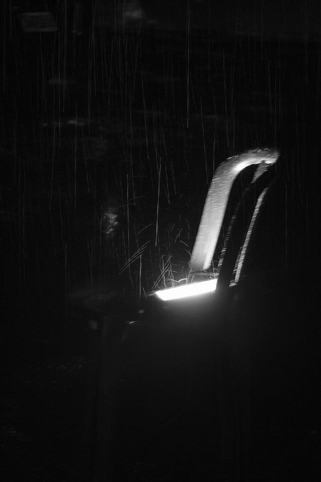 Chair and Lamp under the rain.