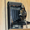 Kodak No 2 Folding Cartridge Premo Camera.   <br /> Camera produced between 1916 and 1922 by Eastman Kodak in the USA.  The camera was designed as an inexpensive camera that met the the needs for amateur picture taking.  The camera is equipped with a meniscus lens with variable aperture setting by lever under the lens labeled as 1 to 4.  There is a Kodak Ball Bearing Shutter with speeds of B, T, 1/25 sec and 1/50 sec.  Uses 120 roll film and produces 6 x 9 cm pictures.  Bellows erect manually on the drop down bed.
