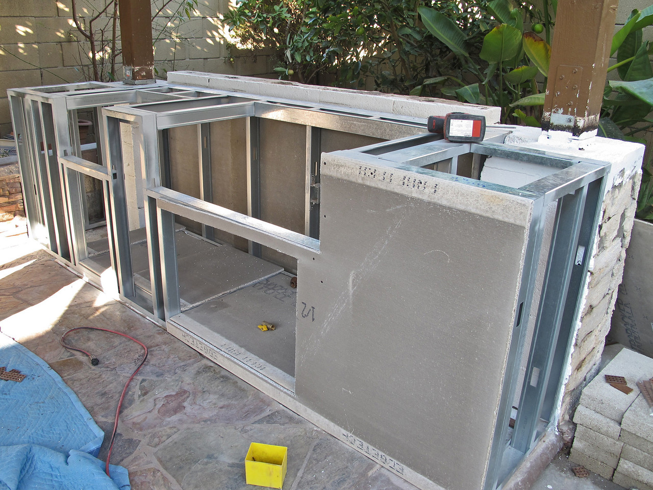 After the frames are level and done, Permabase cement boards were put on to get ready for granite / stone installation.