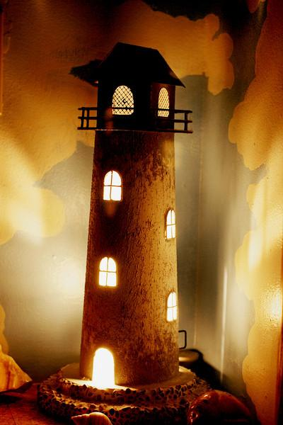 "Minature Lighthouse -  ""Neither do people light a lamp and put it under a bowl. Instead they put it on its stand, and it gives light to everyone in the house.  16 In the same way, let your light shine before men, that they may see your good deeds and praise your Father in heaven.""  (Matthew 5:15-16)"