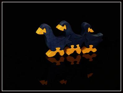 Tris componibile di ochette di ochette in legno dipinto
