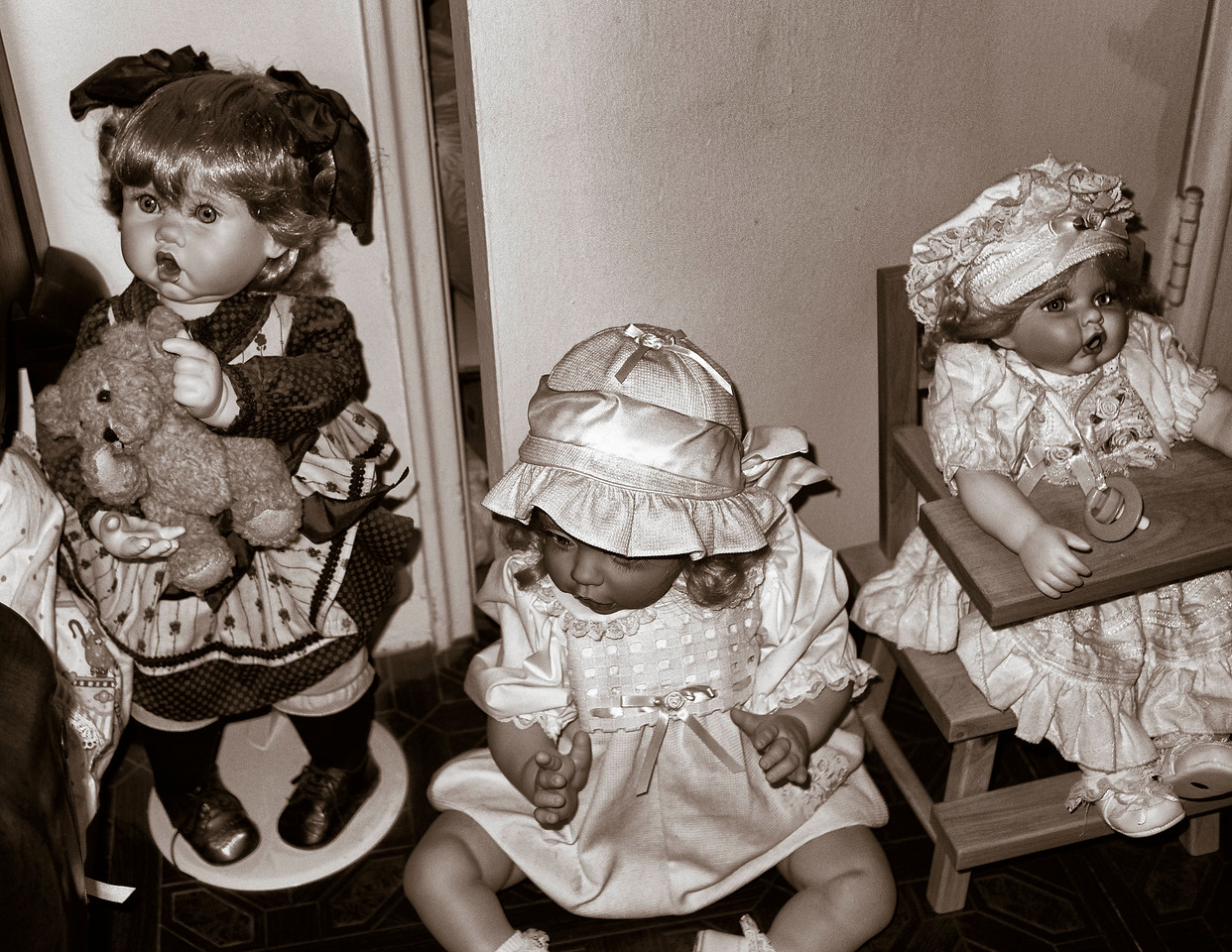 A gallery of doll portraits from a private collection.