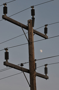 Moon looks tangled in hydro wires. Longlac May 2010