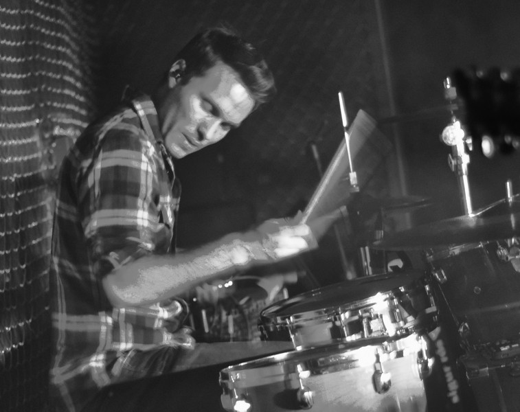 Drummer Erik Johnson of the Denver band Read You and Me, playing a benefit concert to help the local kids in need.