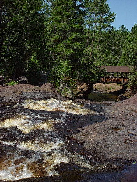 Cascades leading to the Upper Falls and Horton Bridge in Amnicon Falls State Park, WI.