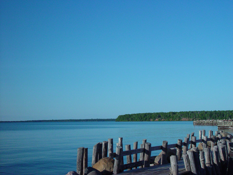 "A view from the side of a fishing shack still in use at ""Little Sand Bay"" near Red Cliff, WI."